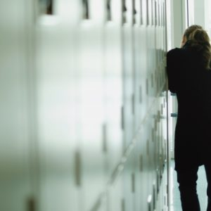 Student peers down hallway