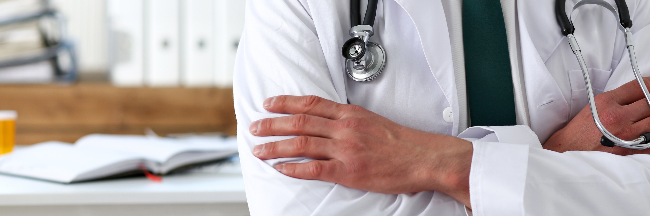 Male medicine doctor hands crossed on his chest in office