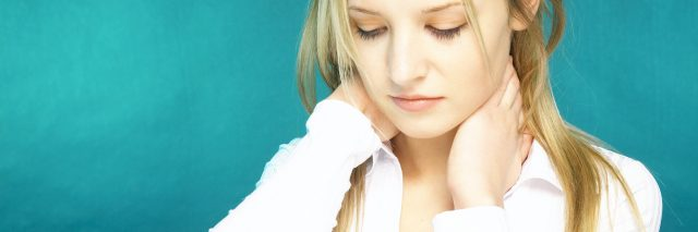 young blonde woman with hands around back of her neck against blue background