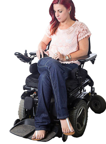 Woman in wheelchair wearing adaptable jeans from alter ur ego