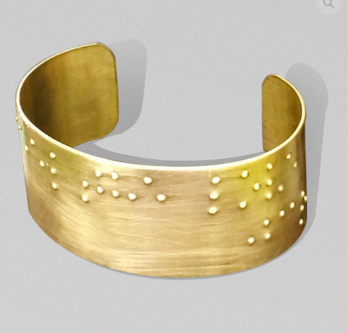 """Golden Cuff with """"feel the love"""" printed in braille"""