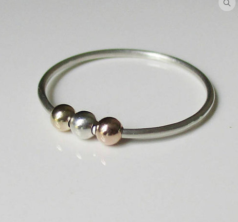 silver fidget ring with gold, silver, and pink beads, by Love Dawne