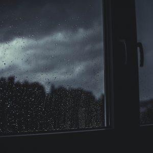 a window showing a dark sky