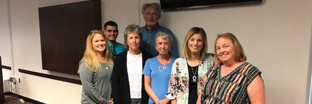 group of people giving a scleroderma talk at a university