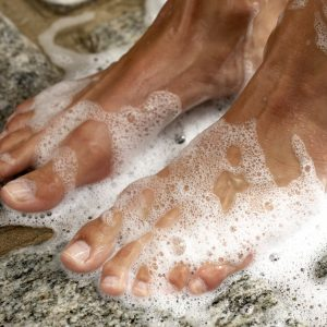 woman's feet in shower