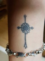 sunflower and cross tattoo