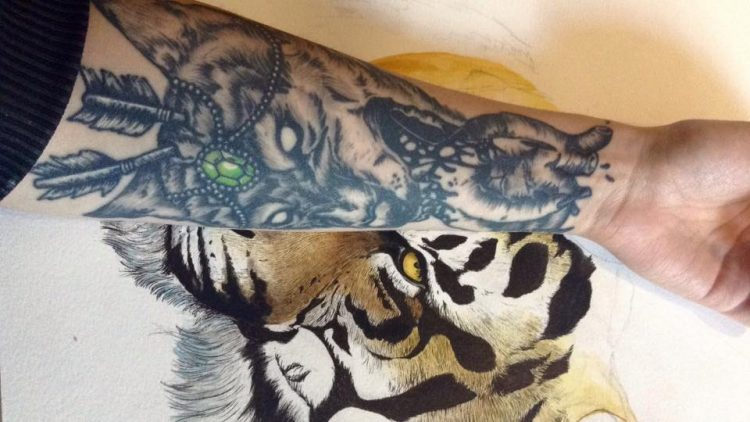 tiger and heart tattoo on forearm