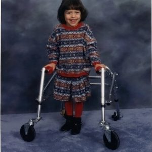 Charisse Hogan, childhood photo of her using a walker.