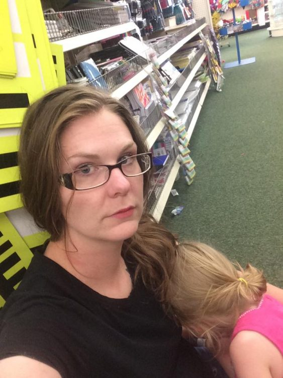 woman sitting on the floor of a store with her daughter