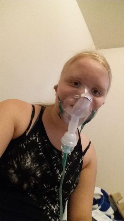 woman wearing a nebulizer