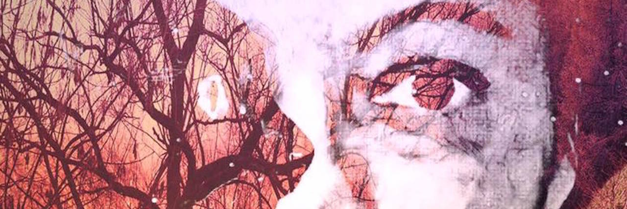 A double exposure photo of the writers face, with a cat and tree background overlapping.