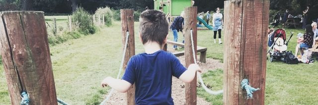 Boy walking down a path at playground