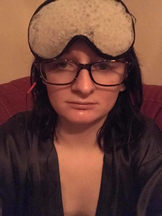woman wearing glasses with an ice pack on her head