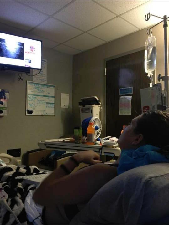 woman watching tv from her hospital bed