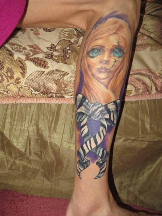 tattoo of girl with cracked face and ehlers-danlos ribbon