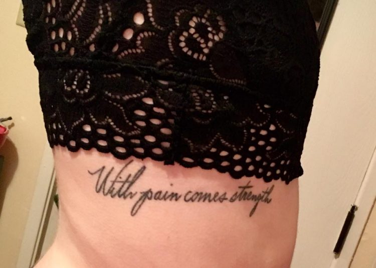 tattoo that says 'with pain comes strength'
