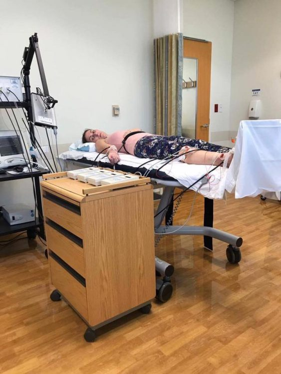 woman lying in a hospital bed to do autonomic testing