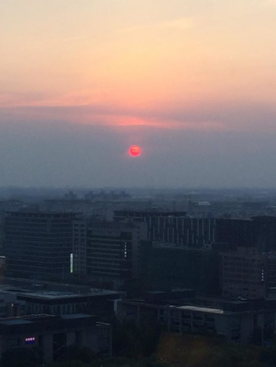 setting sun that looks like a fiery red ball