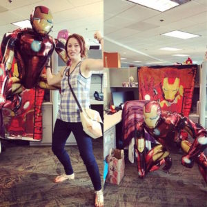 The writer of the article at her desk, decorated with Iron man items.