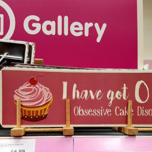 product that says: I have got OCD. Obsessive Cake Disorder.