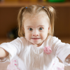 Picture of young teen with Down syndrome and little girl with Down syndrome