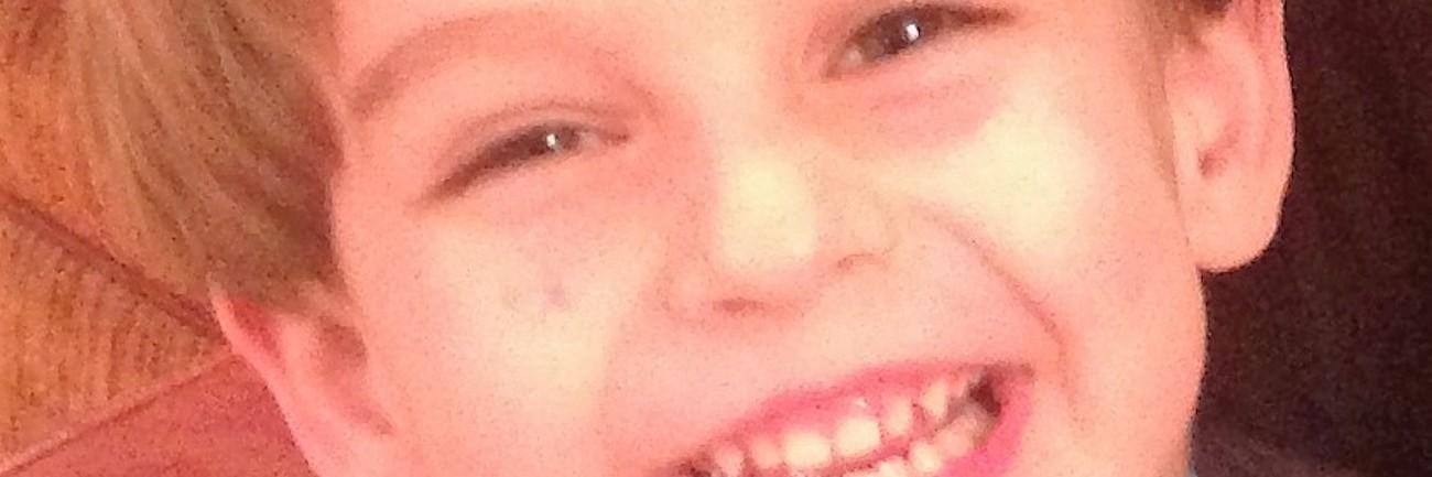 Close-up of boy smiling