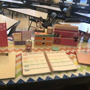 teacher's desk with lesson plans