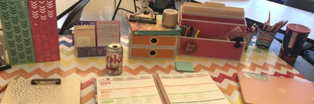 teacher's desk with lesson plans