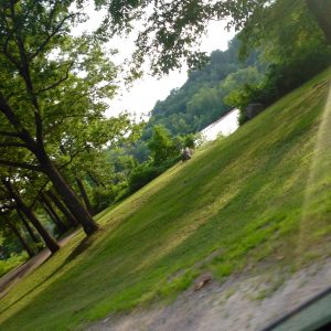 image of lake and rocky outcrop taken from car