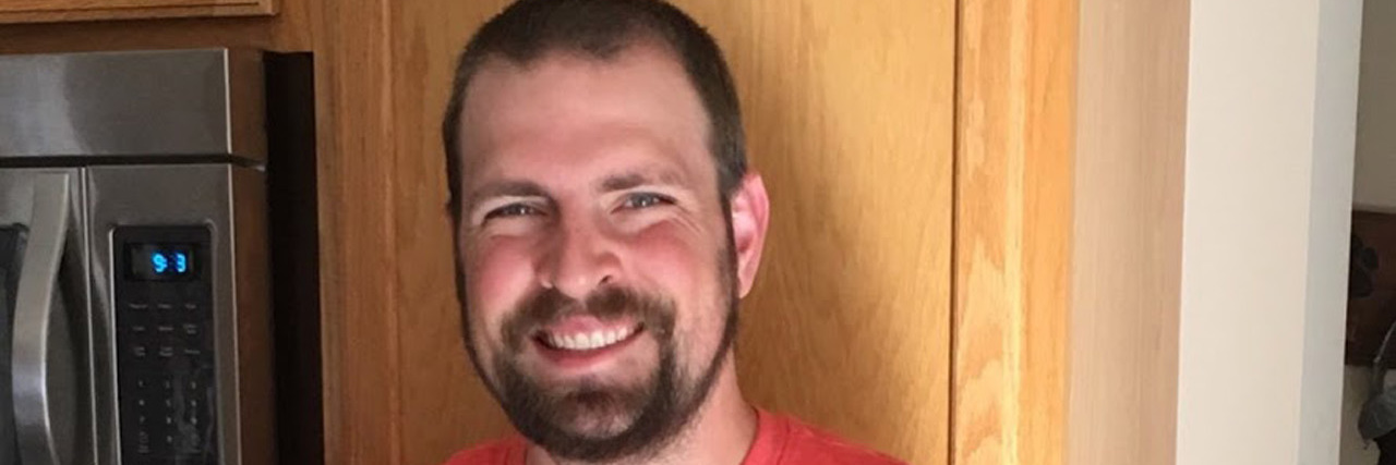 testicular cancer survivor Holding Easter Basket