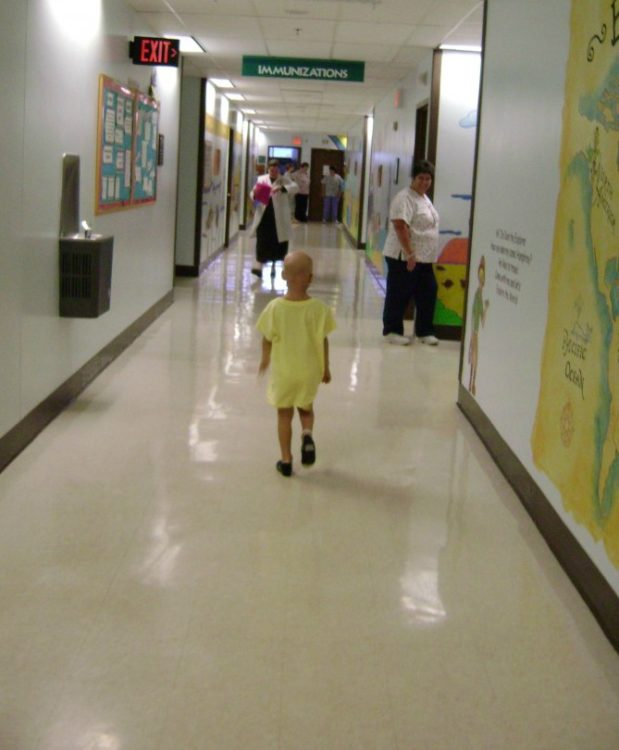 Lily walking down hall of hospital