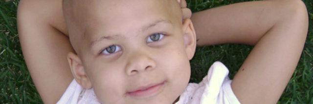 Lily childhood cancer survivor watching clouds