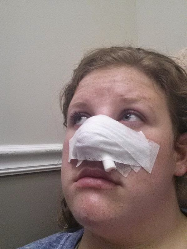 woman with bandage on face after skin cancer surgery
