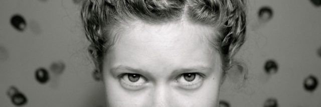 A close-up of the writer's eyes and forehead.