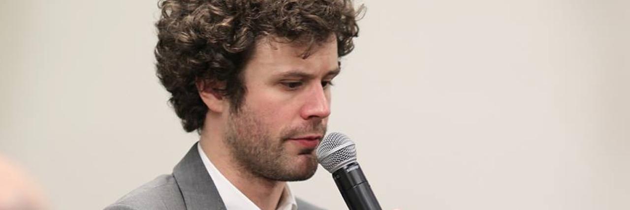 Michael Angelakos speaking