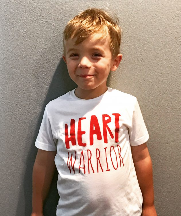 "The writer's young son wearing a shirt that says, ""Heart Warrior."""