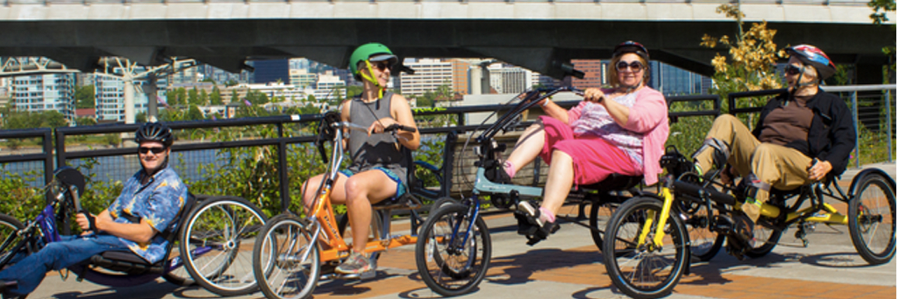 Photo of people riding multiple adaptive bikes