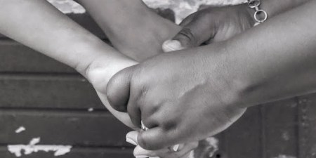 The writer holding her daughter's hands.