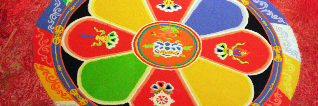 Tibetan mandala on a red background.