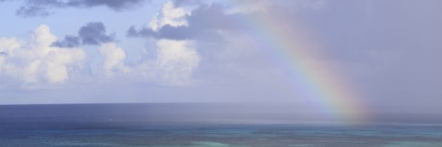 rainbow over the ocean after a storm