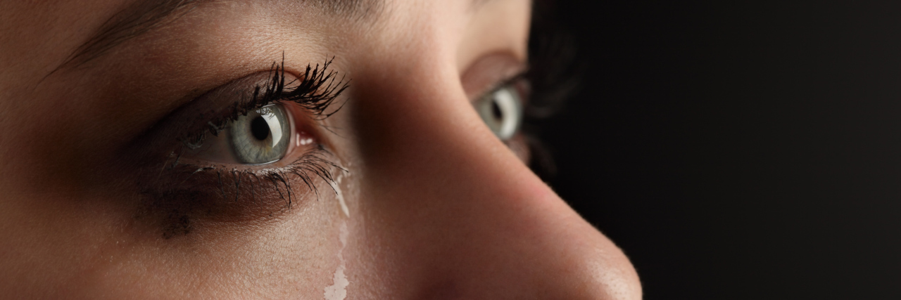 A close-up of a woman crying.