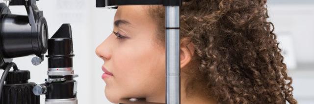 Woman doing eye test.