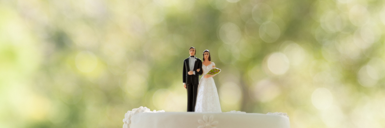 wedding cake and cake topper of bride and groom
