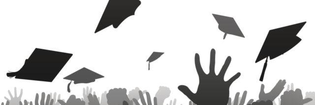Graduates throwing caps.