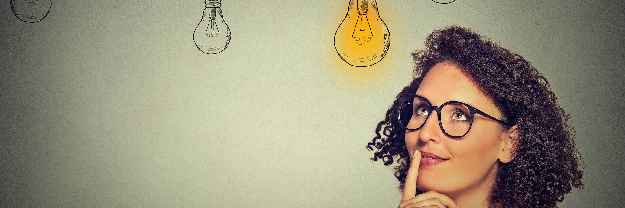 A woman with a lit up light bulb.