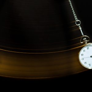 A pocket watch swinging in the air.
