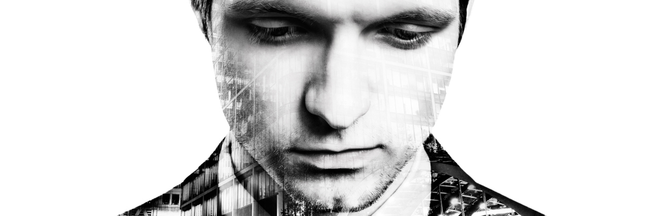 Double exposure of young handsome businessman
