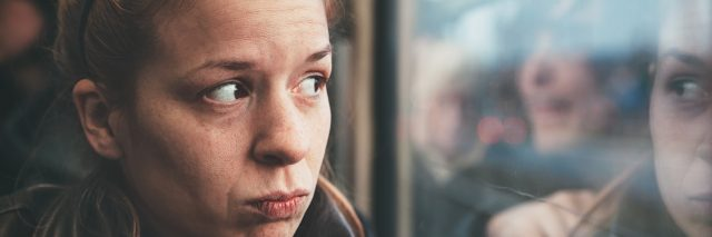 Young woman feeling alone in the public transport