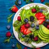 vegan meal with mixed salad leaves berries avocado and honey mustard dressing