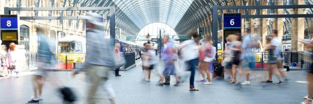 Busy London Underground train station.